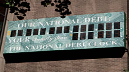 'The National Debt Clock ' is displayed on the side of a building near an Internal Revenue Service office in New York.