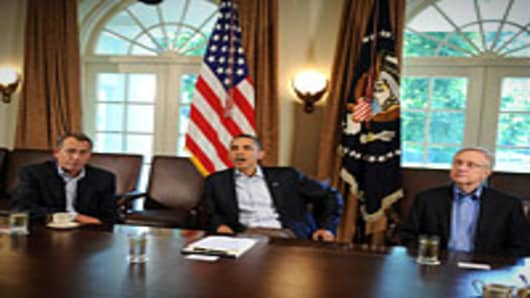 US President Barack Obama (C) speaks with US Speaker of the House John Boehner as Majority Leader Senator Harry Reid looks on during a meeting in the Cabinet Room at the White House in Washington, DC, on July 23, 2011.