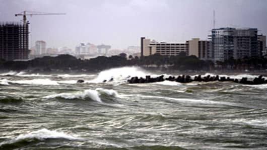 Raging waves batter against the shore in the seafront in Santo Domingo, Dominican Republic, after the passage of Hurricane Irene. Hurricane Irene was downgraded on Tuesday as it lashed the Turks and Caicos Islands in the Caribbean, but forecasters warned it could still regain power as it approaches the US mainland.