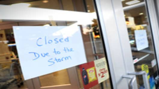 A 'closed' signs hang on the door of a convenience store in preparation for Hurricane Irene August 26, 2011 in Villas, New Jersey.