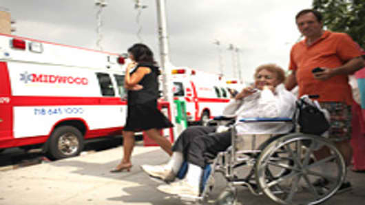Ambulances wait to evacuate patients at Coney Island Hospital due to the impending Hurricane Irene, which is expected to make landfall in New York City sometime late tomorrow or early the next day, on August 26, 2011 in New York City.