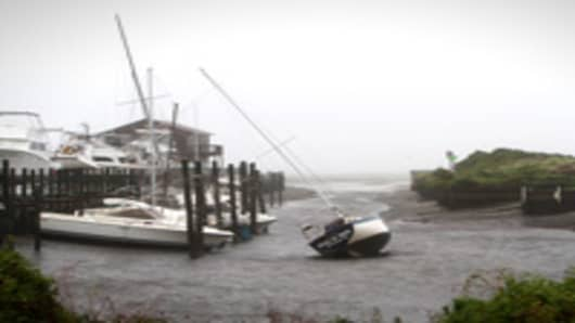 Boats sit out of the water at Pamlico Sound in Buxton, North Carolina, on Saturday, Aug. 27, 2011. Hurricane Irene made landfall on the North Carolina coast this morning after a night of driving rain and wind in a storm that forced evacuations along the Eastern Seaboard.