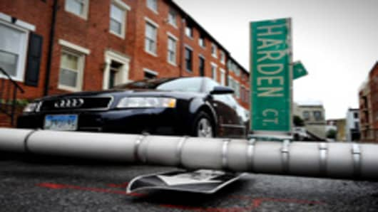 A street signs lays in the street after falling over as Maryland deals with the after-effects of Hurricane Irene on August 28, 2011 in Baltimore, Maryland. Hurricane Irene caused some power outages but no significant damage or flooding throughout the Baltimore region.