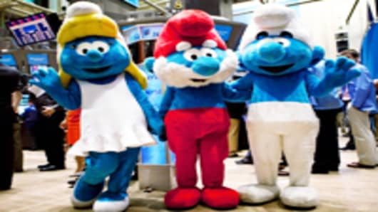Actors dressed as Smurfs on the floor of the New York Stock Exchange during morning trading on July 29 promote the film 'The Smurfs in 3D,' before markets went into a tailspin.