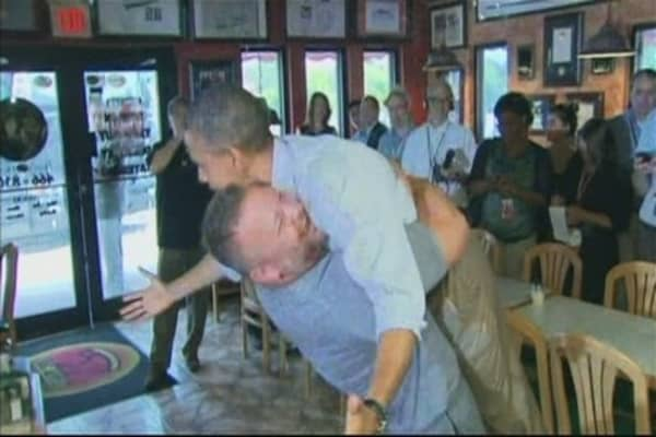 President Obama Hugged by Pizza Making