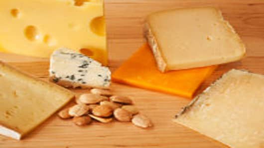 Various cheeses on chopping board