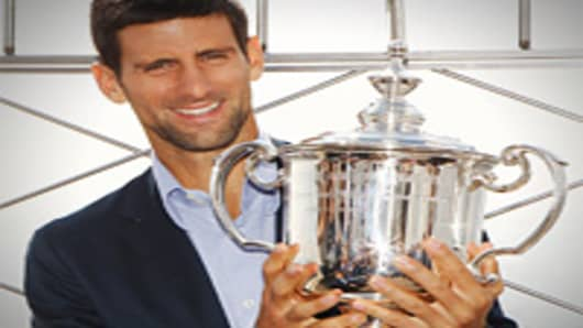 2011 US Open Singles Men's Champion Novak Djokovic of Serbia poses with his trophy atop the Empire State Building on September 13, 2011 in New York City, New York.