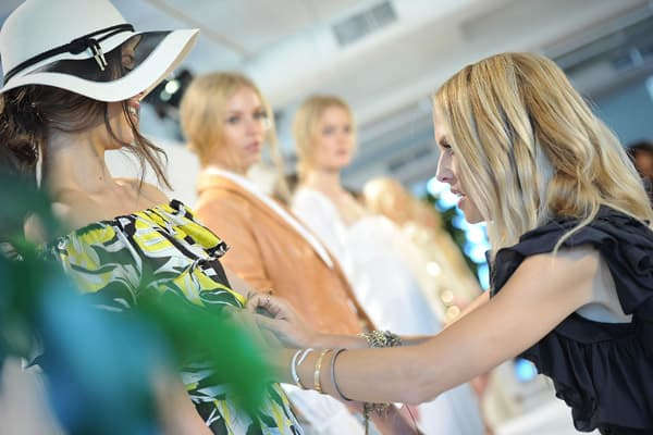 Designer Rachel Zoe makes some last minute adjustments to clothing a model is wearing at the Rachel Zoe spring 2012 presentation during Mercedes-Benz Fashion Week on Sept. 12, 2011, in New York City.