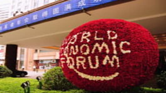 "A flower bouquet made up of 36,000 red roses and 4,000 white roses is placed at the entrance of Shangri-La Hotel to welcome participants on September 13, 2011 in Dalian, Liaoning Province of China. The three-day 2011 Summer Davos Forum will open on September 14 in Dalian with the theme of ""Mastering Quality Growth""."