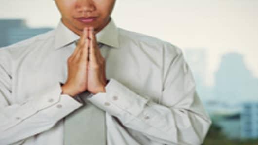 praying_man_suit_200.jpg