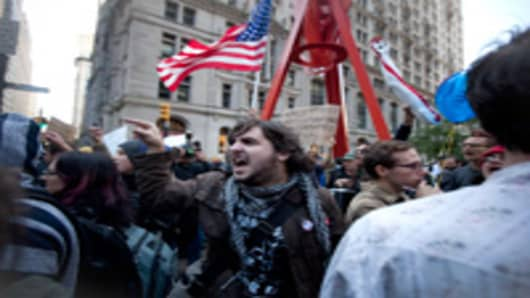 People scream at the New York police officers after an arrest was made on Broadway in front of Zuccotti Park, where demonstrators protesting against the financial system are gathering on September 19, 2011 in New York City.
