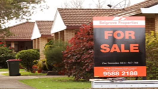'For Sale' sign is seen outside a property in Sydney, Australia.