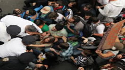 Police arrest demonstrators affiliated with the Occupy Wall Street movement after they attempted to cross the Brooklyn Bridge on the motorway in New York City.