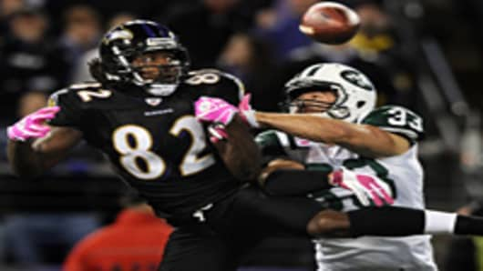 Torrey Smith of the Baltimore Ravens tries to pull in a pass against safety Eric Smith of the New York Jets on October 2, 2011.