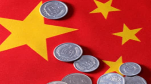 Chinese yuan coins on China's flag