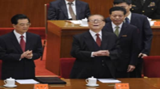 Chinese president Hu jintao stands with former president Jiang Zemin at the commemoration of the 100th anniversary of the Xinhai Revolution at the Great Hall of the People in Beijing on October 9, 2011.