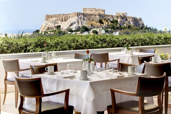 This opulent hotel, located just across the street from the embattled Greek parliament, offers guests breathtaking views of the Parthenon and the Acropolis – a 20-minute walk away.Opened in 1874, the Grand Bretagne remains a favorite with American tourists. Notable guests who have stayed over the years include Winston Churchill, Joan Collins, Jacques Chirac and Jean Paul Gaultier.The Grand Bretagne offers everything a VIP would expect, from a vast marble lobby stuffed with neo-Baroque furniture