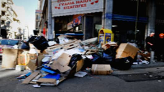 "Heaped rubbish remains uncollected in Athens, Greece. Bin men have begun a strike with officials warning of a ""health time bomb""."