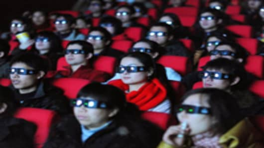 Chinese movie-goers wear 3-D glasses