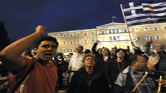 Greek indignants chant slogans at central Athens Syntagma squar in front of the Greek Parliament during a demonstration on October 15, 2011. Inspired by the Occupy Wall Street movement in the United States and Spain's 'Indignants', people began taking to the streets across the world, targeting 951 cities in 82 countries. AFP PHOTO/ LOUISA GOULIAMAKI (Photo credit should read LOUISA GOULIAMAKI/AFP/Getty Images)