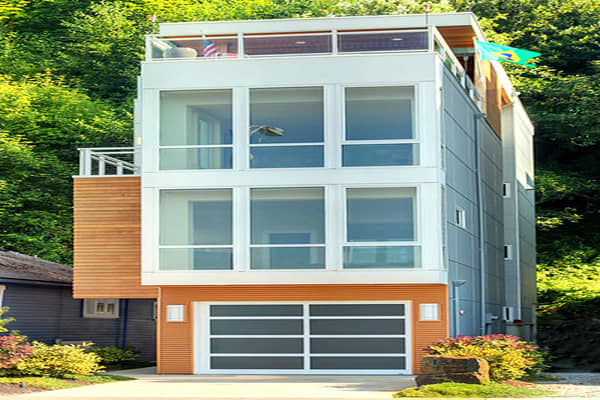 Price: $1,850,000Bedrooms: 4Bathrooms: 3Square Footage: 3,530This architecturally modern   overlooks the Puget Sound. While not much wider than the single-car garage it's built over, the wall of windows facing the view help it feel spacious. It has flooring of cork, slate, concrete, ceramic tile, and bamboo, an elevator in which to ascend to the roof deck, which has a stainless steel gas fireplace, custom lighting, and is wired for TV and Internet.