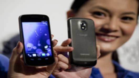 Samsung Electronics unveils the Galaxy Nexus smartphones, running Google's Ice Cream Sandwich Android operating system, in Hong Kong, China, on Wednesday, Oct. 19, 2011.