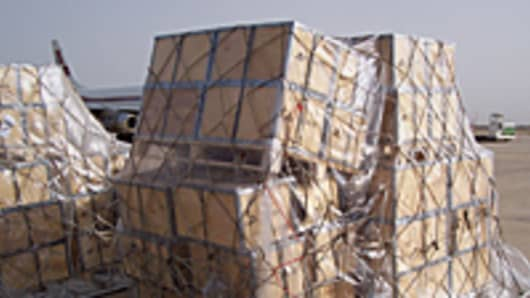 Pallets of cash unloaded on to the tarmac at Baghdad International Airport.