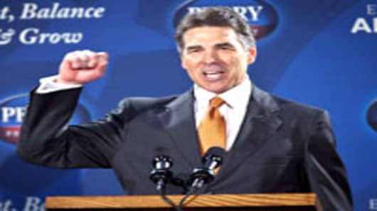 Republican presidential candidate Gov. Rick Perry outlines his flat tax plan at the ISO Poly Films factory on October 25, 2011 in Gray Court, South Carolina.