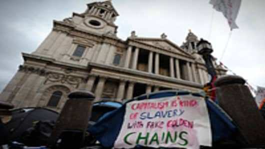 An anti-capitalist banner is pictured outside St Paul's Cathedral in London, on October 31, 2011. The head of St Paul's Cathedral resigned on Monday due to criticism he faced over moves to evict protesters inspired by the Occupy Wall Street movement from outside the London landmark.