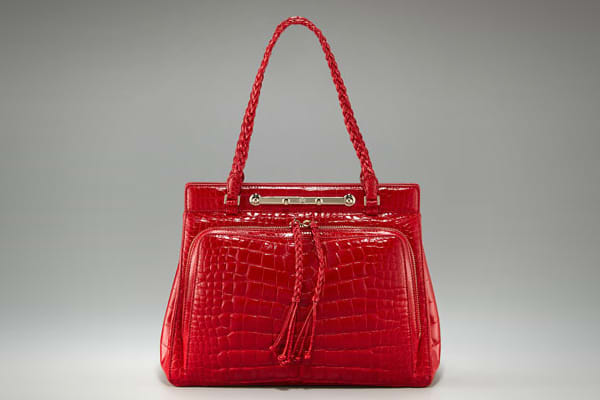 """Price: $19,500 Valentino Creative Directors Pierpaolo Piccioli and Maria Grazia Churi introduced the Demetra bag as part of their """"Goddess Collection."""" Valentino's limited edition Demetra collection bags are exclusive to The prim top-handle bag, pictured here, features structured lines and braided detailing to create a couture classic. Only three of this extremely limited edition bag exist worldwide, one each in red, green, and black. A smaller tote version is available as well, with a similarly"""