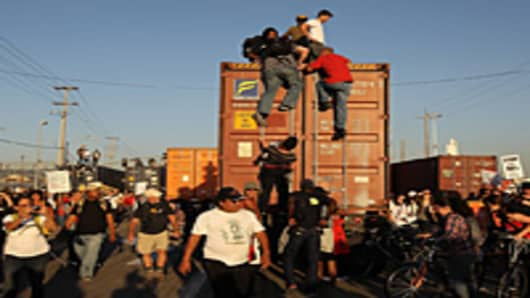 rotestors climb on a truck at the Port of Oakland during Occupy Oakland's general strike on November 2, 2011 in Oakland, California.