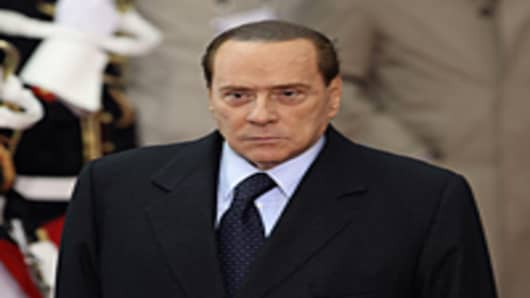 Italian Prime Minister Silvio Berlusconi leaves the conference centre after the first day of the G20 Summit on November 3, 2011 in Cannes, France.