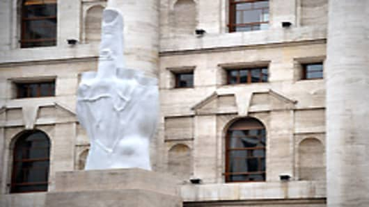A general view of Maurizio Cattelan's controversial statue on March 15, 2011 in Milan, Italy. The work L.O.V.E., located in front of the Milan Stock Exchange, depicts a hand with four severed fingers and the middle finger up.