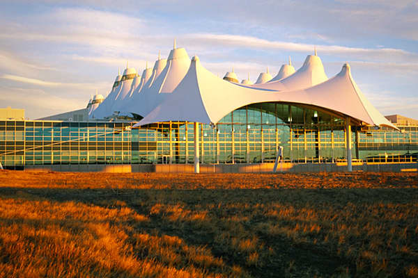 Denver's airport, or DIA, which opened in 1996, is routinely voted the best airport in North America by Business Traveler magazine balancing passenger safety and providing an enjoyable experience. The terminal's peaked roof resembles a village of giant white teepees, against the backdrop of the Rocky Mountains. Denver-based architect Curtis Fentress, a pioneer in sustainable design, made the airport as green as possible, with solar power operations, and a roof made of materials which reflect 20