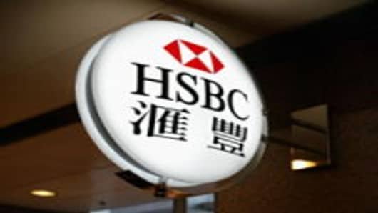 A sign featuring the logo of the banking giant HSBC hangs outside a branch on December 11, 2003 in Hong Kong. The London-based bank, which operates in 79 countries, gave an upbeat tone for the global economy March 1, 2004 including its key Hong Kong market by reporting a record annual pre-tax profit of ?7.7bn ($14.4). (