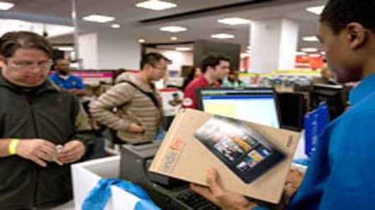 A customer purchases the Amazon.com Inc. Kindle Fire tablet computer at a Best Buy Co. store in New York, U.S., on Tuesday, Nov. 15, 2011. Amazon.com Inc.