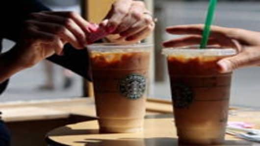 A couple has iced coffee drinks at a Starbucks Coffee shop in lower Manhattan August 21, 2009 in New York City. Starbucks, America's dominant coffeehouse chain, is changing some of its prices, raising them for elaborate specialty drinks and cutting prices for some others.