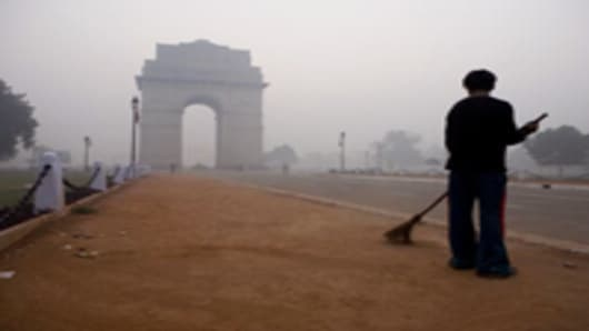 The India Gate, a war memorial, covered in haze in New Delhi, India.