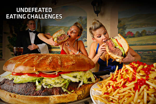 "For many people, the word eating challenge evokes the iconic scene in the movie when John Candy tackles ""The Old 96er"" to the chagrin of his digestive tract. More recently, the Travel Channel's has popularized eating challenges, which have increasingly become a strategy for restaurants across the country to make a name for themselves, draw in new customers and simply have fun with their menus. For those testing their fortitude through eating challenges, clearing a plate of outrageously large or"
