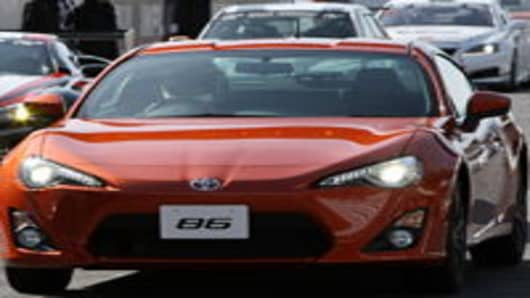 The Toyota Motor Corp. 86 sports coupe is driven by Akio Toyoda, president of Toyota Motor Corp., during its unveiling at Fuji Speedway in Oyama Town, Shizuoka Prefecture, Japan, on Sunday, Nov. 27, 2011. Toyota Motor Corp. introduced its new 86 coupe today, betting that the 200-horsepower sports car will widen the Japanese automaker's appeal beyond its best-selling Camry sedan and Prius hybrid.