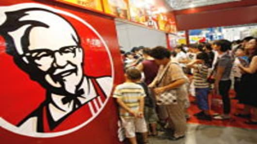 Customers line up to buy Kentucky Fried Chicken in Beijing.