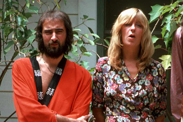 "The popular 1970s rock group Fleetwood Mac began in the 1960s as a blues band. When original guitarist Peter Green left, the remaining members decided to pursue a pop sound, and bassist John McVie asked his wife, keyboard player and singer, Christine, to join the band in 1970. Fleetwood Mac gained in popularity over the next few years, but the McVies' marriage crumbled.In 1977, the couple divorced,. At the same time, the band released its most successful album, ""Rumours,"" which reached  on the"