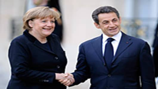 France and Germany want a new European Union treaty for all 27 members or for the 17 members of the eurozone with other nations signing on a voluntary basis, President Sarkozy said today
