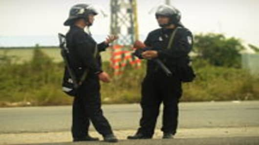 Armed Chinese police in riot gear man a roadblock on the route to the village of Wukan in Guangdong province.