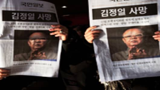 newspapers-on-kim-death_200.jpg