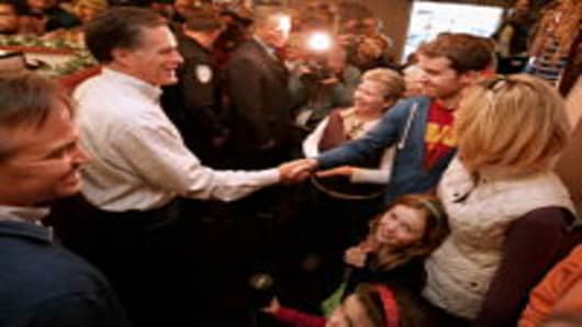 Republican presidential candidate Mitt Romney greets supporters during campaign event at the Family Table Restaurant in Le Mars, Iowa on December 31st.