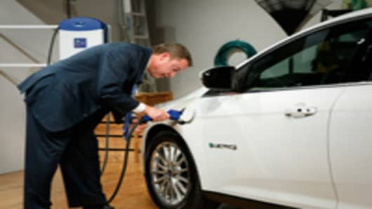 Ford Executive Chairman Bill Ford charges the Ford Focus EV during the vehicle's reveal in early 2011.
