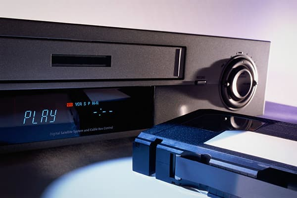 Introduced at CES: 1970 Decades before the introduction of digital recording devices, like TiVo and the DVR, the buzz surrounded a device called the VCR. This device recorded TV programs on an analog VHS tape. Although the VCR didn't receive mass-market success right away, a decade later it was in use by most American households. The VCR revolutionized home entertainment, allowing audiences to experience movies in their homes - instead of just in theaters – and paved the way for the now ubiquito