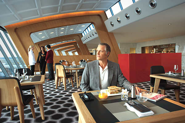 Qantas's luxury lounge in many ways reflects Australia's great outdoors. The lounge prominently features a vertical garden that includes 8,400 plants. Once you're soothed by the garden, you can choose from a variety of activities including free treatments at a Payot Paris day spa. There's a 48-seat, open-kitchen restaurant, and chair-side waiter service throughout the lounge, if you can't be bothered to move. Entertainment areas include plasma screens and Sony Playstation entertainment systems.