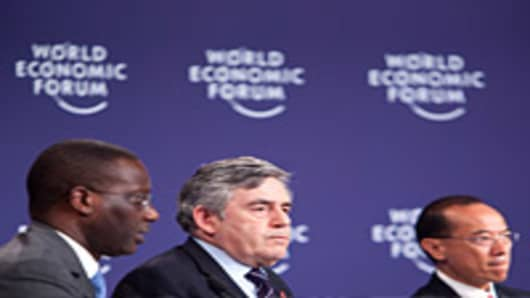 Gordon Brown, former U.K. prime minister, center, participates in a panel discussion with Tidjane Thiam, chief executive officer of Prudential Plc, left, and George Yeo, Singapore's foreign minister, at the World Economic Forum (WEF) Annual Meeting.